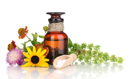 14953606 - medicine bottle with tablets and flowers isolated on white