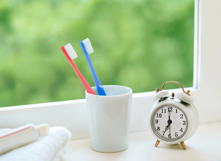 28440067 - toothbrush and alarm clock